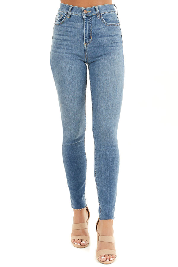 Light Denim High Rise Cropped Skinny Jeans with Raw Hem front view
