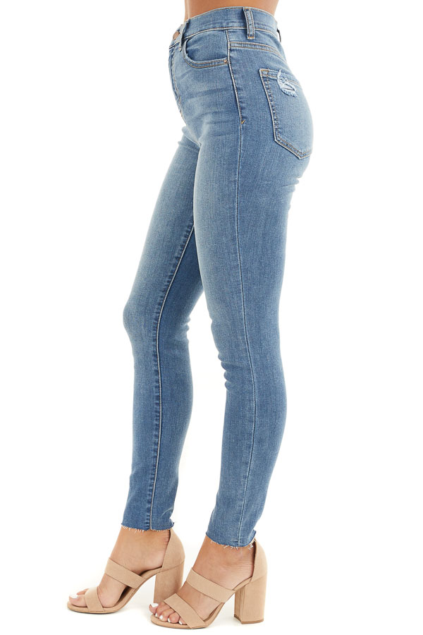 Light Denim High Rise Cropped Skinny Jeans with Raw Hem side view