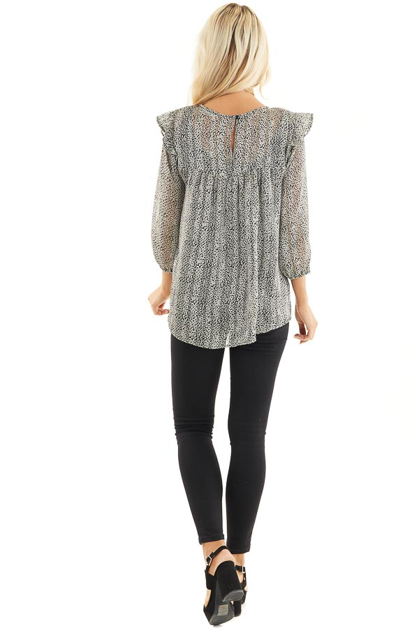 Black and Ivory Printed Sheer Blouse with Ruffle Details back full body