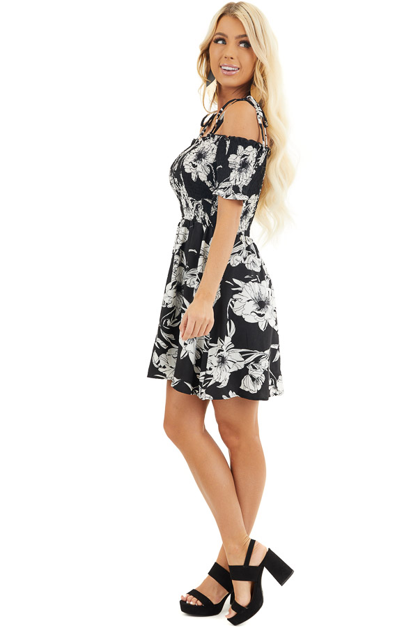 Black and White Floral Smocked Mini Dress with Strap Details side full body