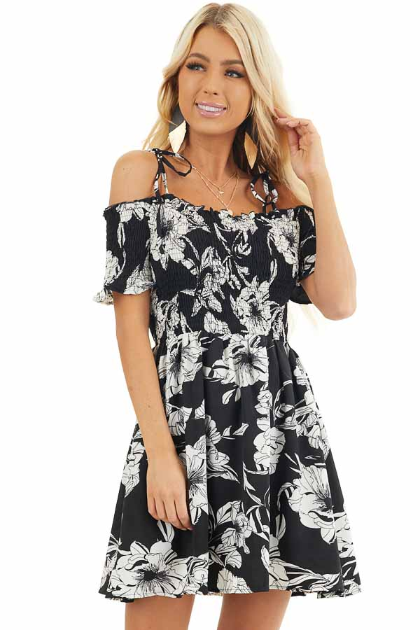 Black and White Floral Smocked Mini Dress with Strap Details front close up