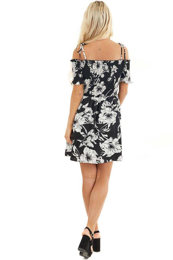 Black and White Floral Smocked Mini Dress with Strap Details back full body