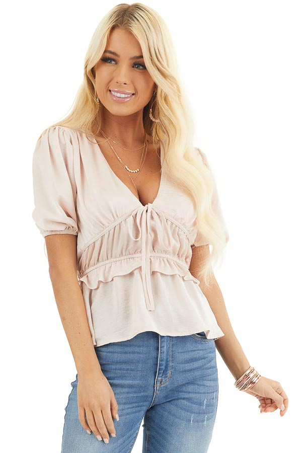 Pale Pink Silky V Neck Peplum Blouse with Bow Detail front close up