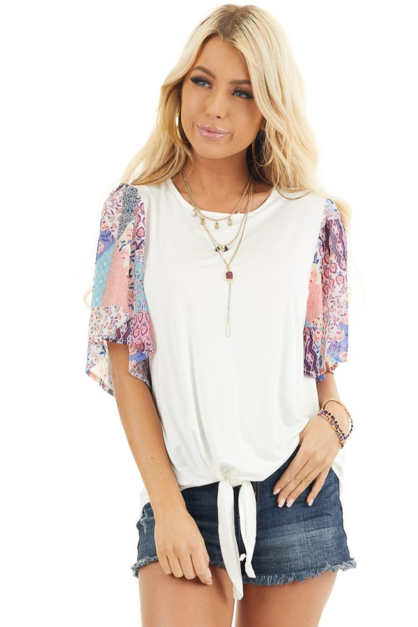 White Short Sleeve Knit Top with Floral Print Details front close up