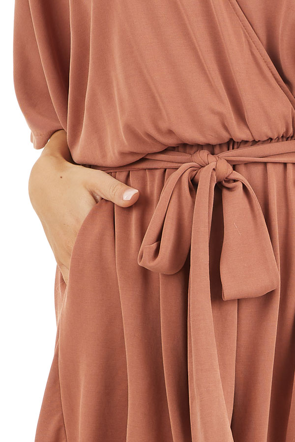 Terracotta Surplice Romper with Short Sleeves and Waist Tie detail