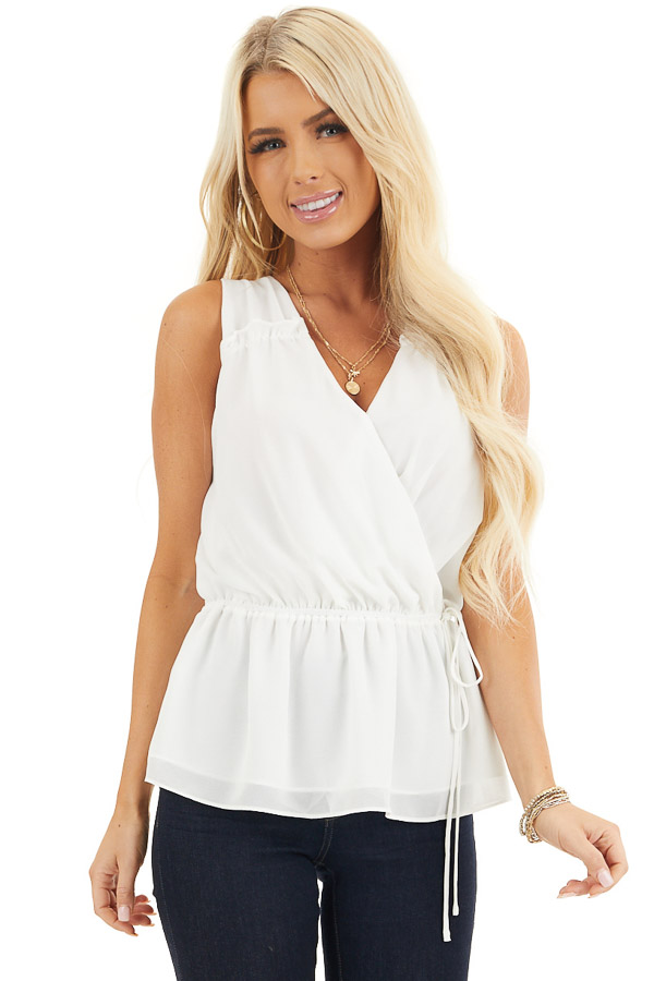 Ivory Sleeveless Surplice Blouse with Elastic Waist and Tie front close up