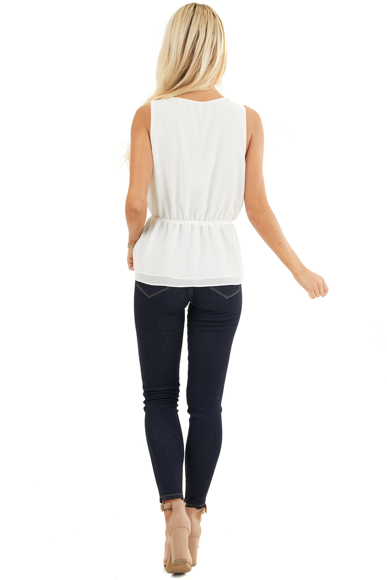 Ivory Sleeveless Surplice Blouse with Elastic Waist and Tie back full body
