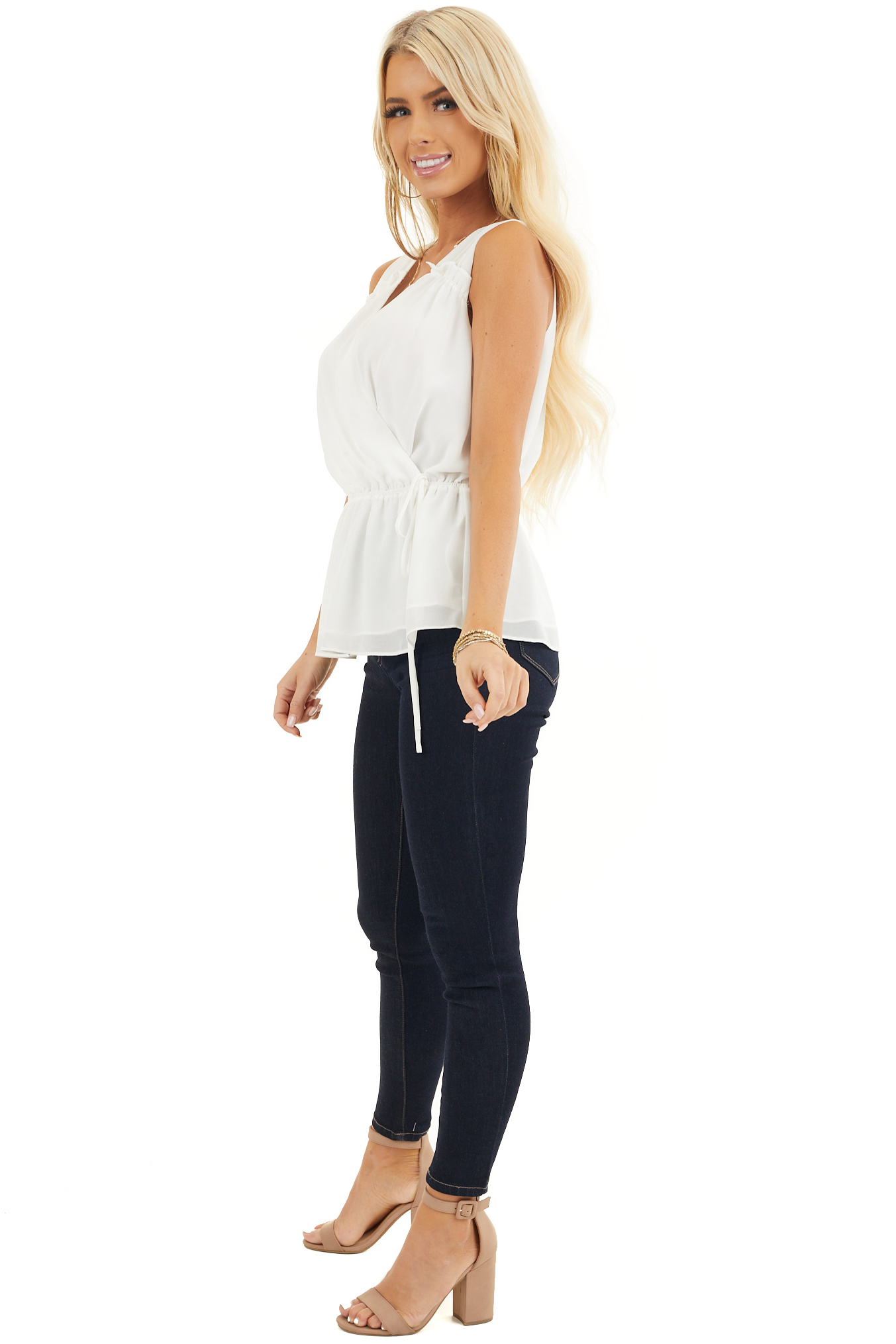 Ivory Sleeveless Surplice Blouse with Elastic Waist and Tie side full body
