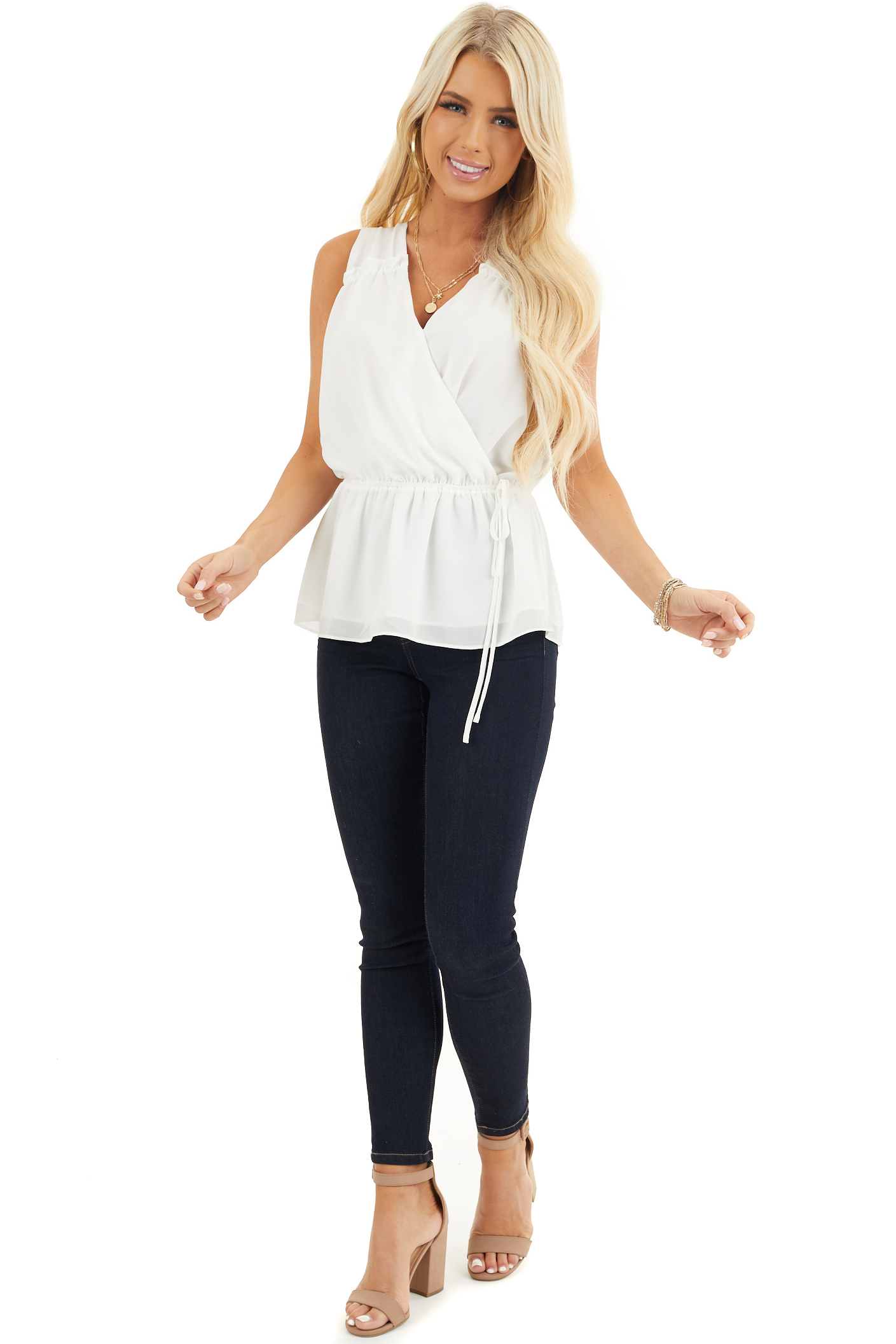 Ivory Sleeveless Surplice Blouse with Elastic Waist and Tie front full body