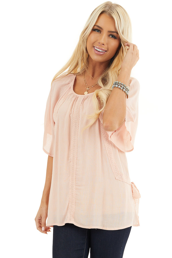 Blush Short Sleeve Top with Crochet Lace and Tie Detail front close up