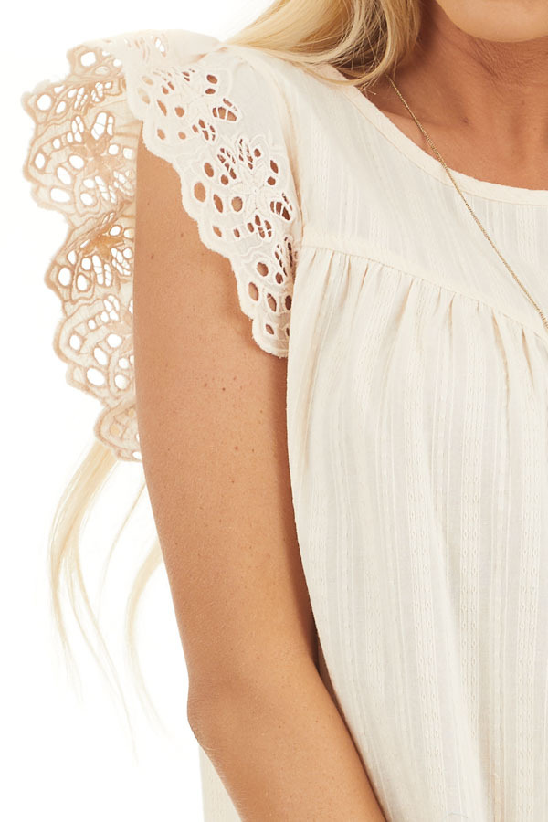 Cream Short Sleeve Eyelet Embroidery Top with Keyhole Back detail