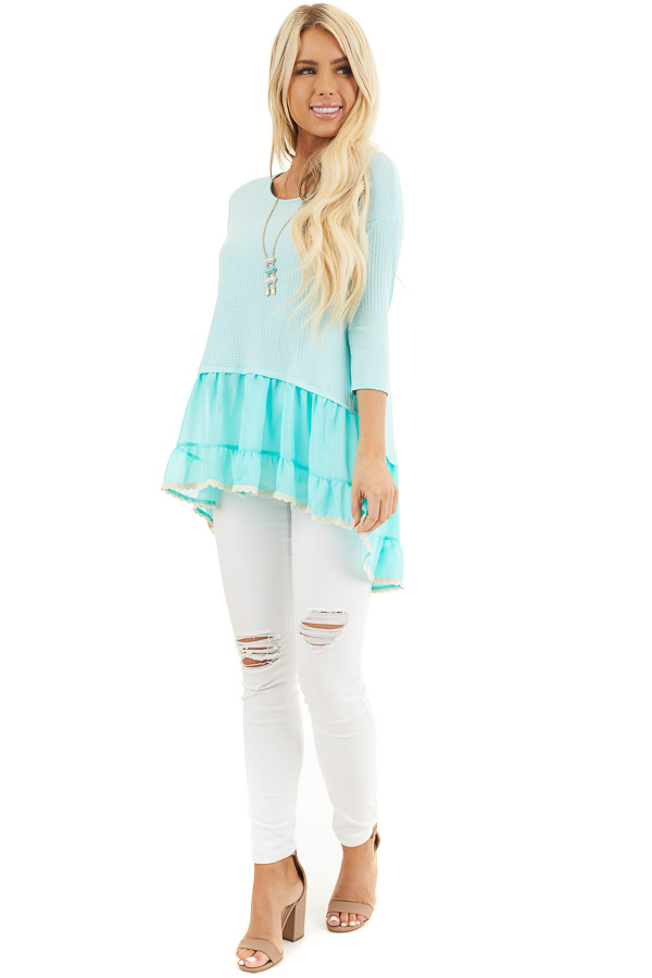 Bright Aqua Striped Top with Contrasting Ruffled Hemline front full body