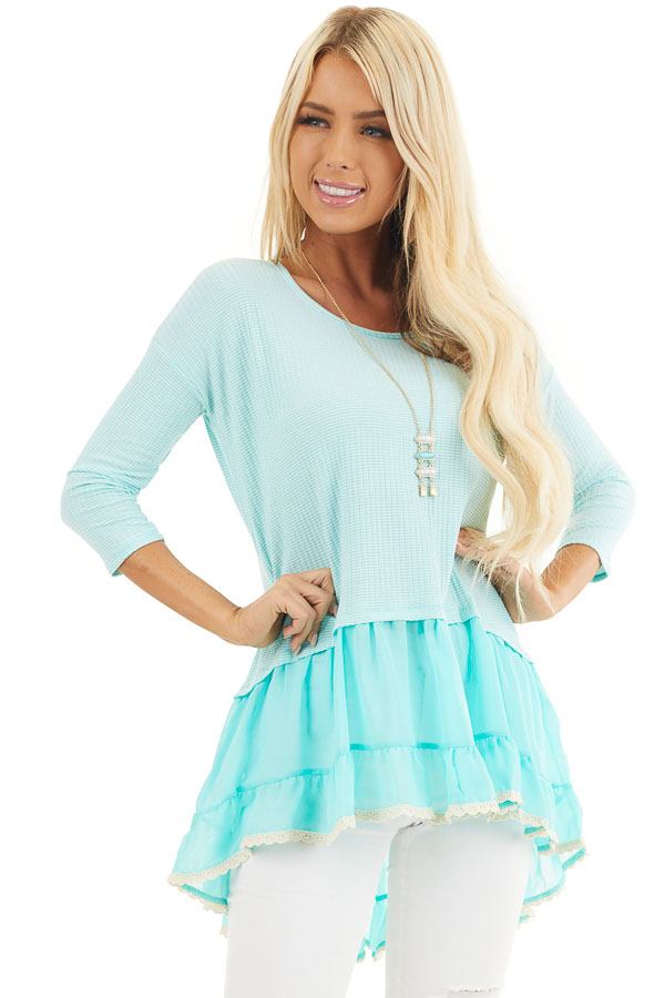 Bright Aqua Striped Top with Contrasting Ruffled Hemline front close up