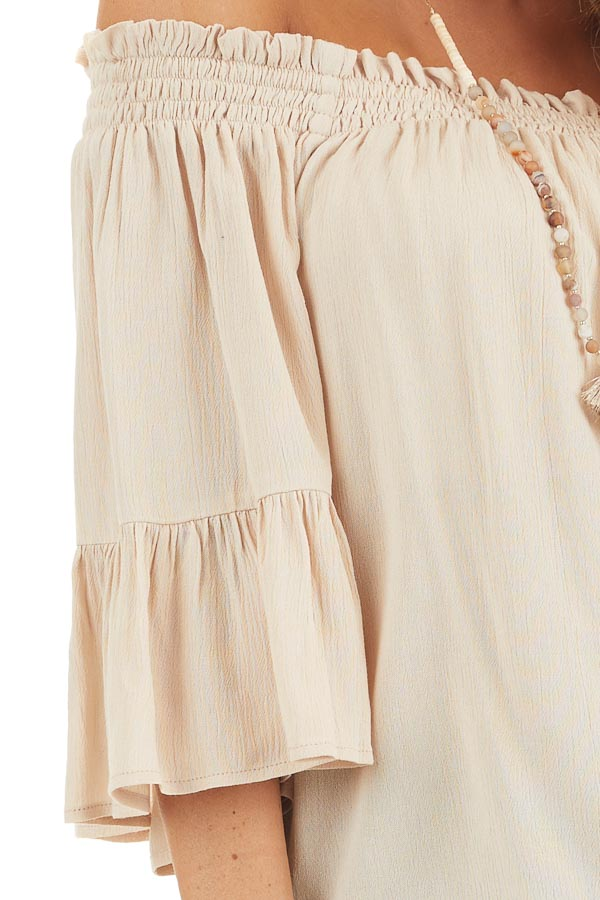 Beige Off the Shoulder Top with 3/4 Length Sleeves detail