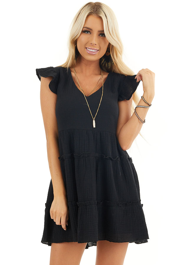 Black Short Sleeve Tiered Dress with V Neckline and Ruffles front close up