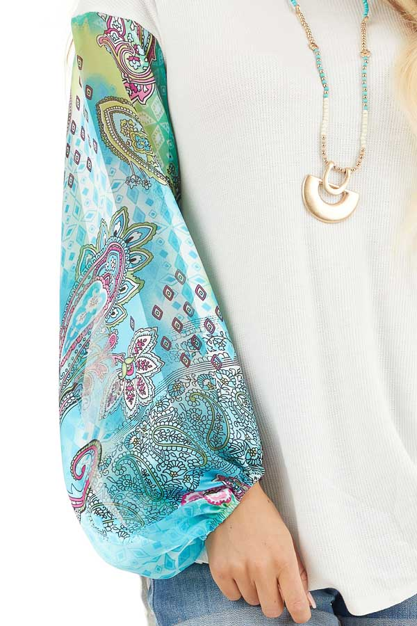 White Waffle Knit Top with Multicolor Paisley Print Sleeves detail