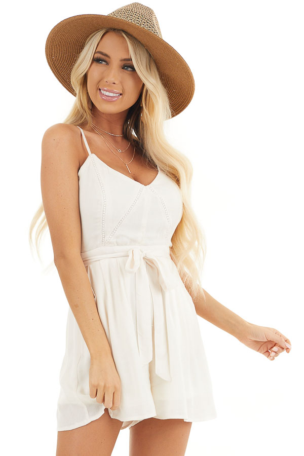 Cream Spaghetti Strap Romper with Crochet Lace and Waist Tie front close up