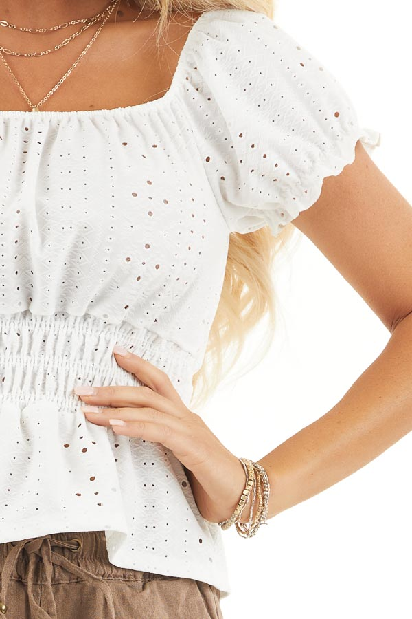 White Sheer Knit Top with Smocked Waist and Puff Sleeves detail