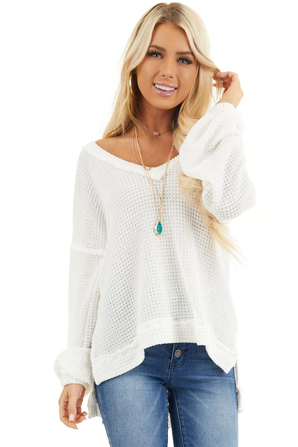 Ivory Long Sleeve V Neck Knit Top with Side Slits front close up
