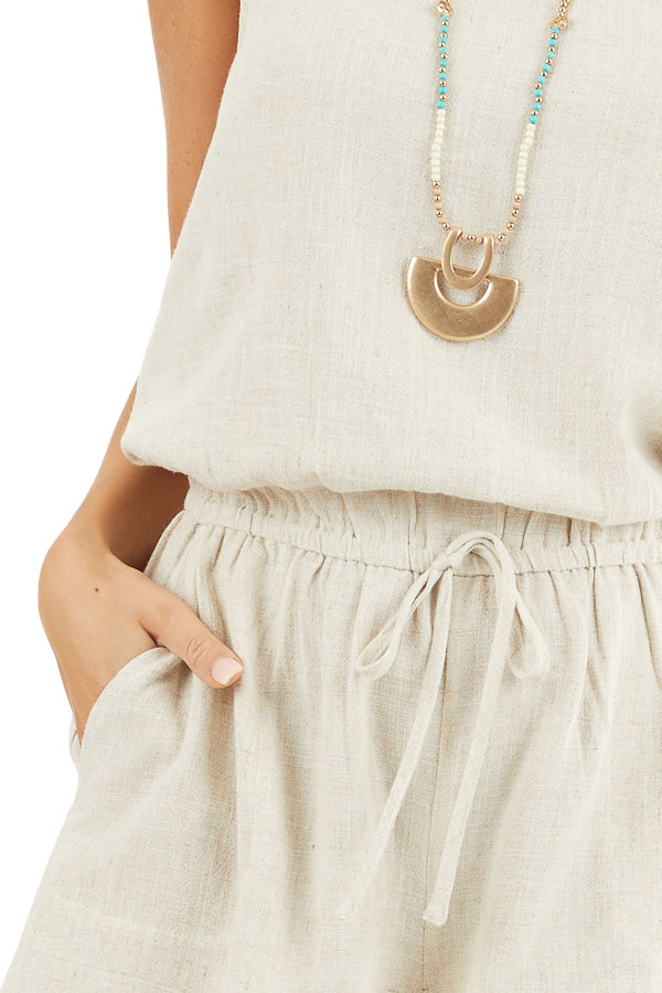 Oatmeal Sleeveless Romper with Elastic Waist and Pockets detail