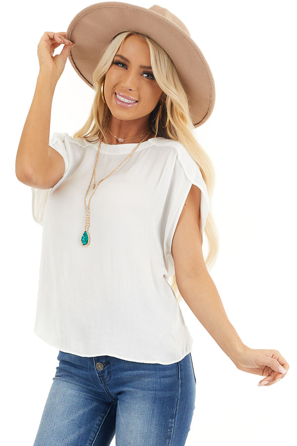 Off White Short Sleeve Blouse with Button Up Back Detail front close up
