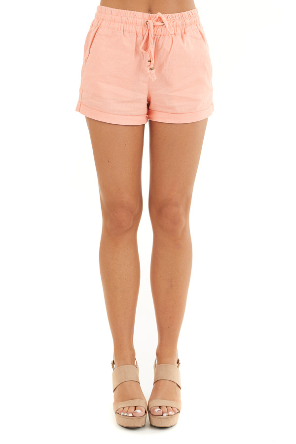 Coral Mid Rise Smocked Shorts with Pockets and Drawstring front view