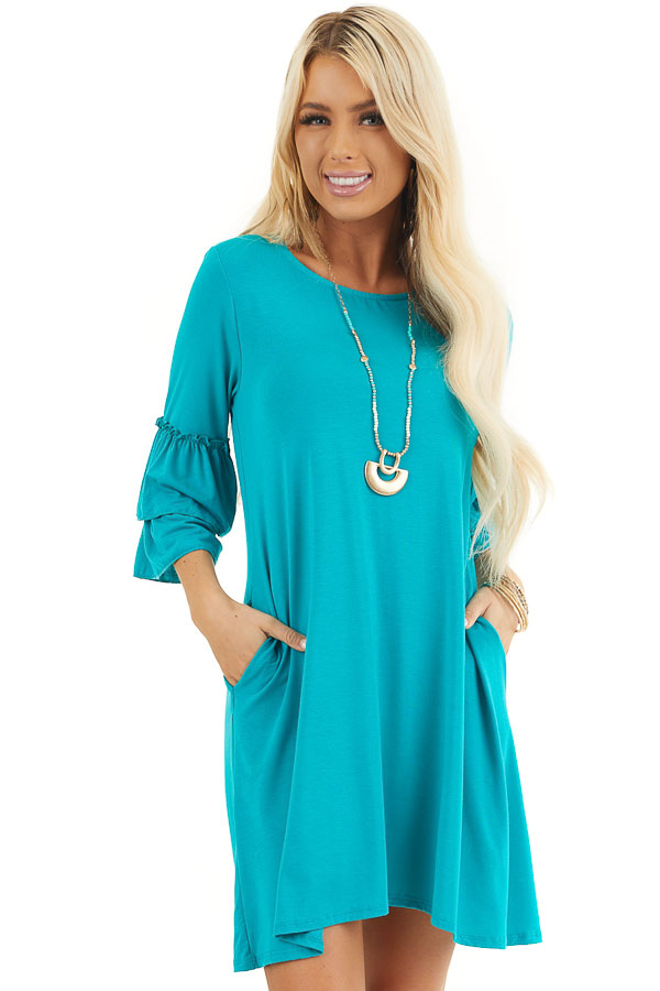 Bright Teal Knit Dress with 3/4 Dual Ruffle Trumpet Sleeves front close up