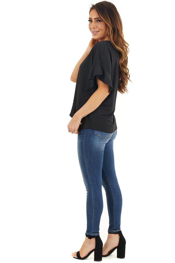 Black V Neck Knit Top with Short Sleeves and Ruffle Details side full body