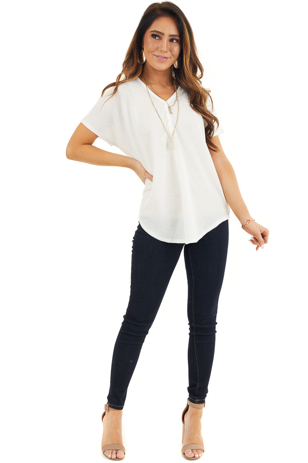 Off White Short Sleeve Knit Top with Button Down Detail front full body