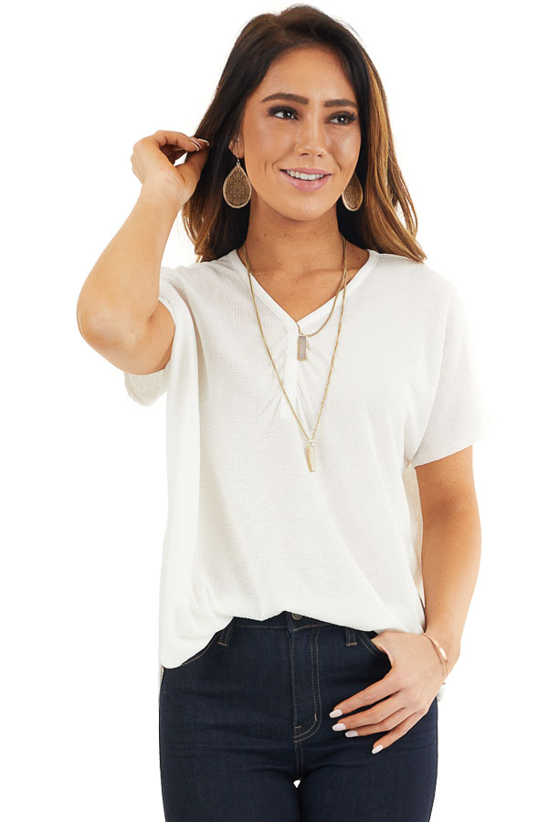 Off White Short Sleeve Knit Top with Button Down Detail front close up