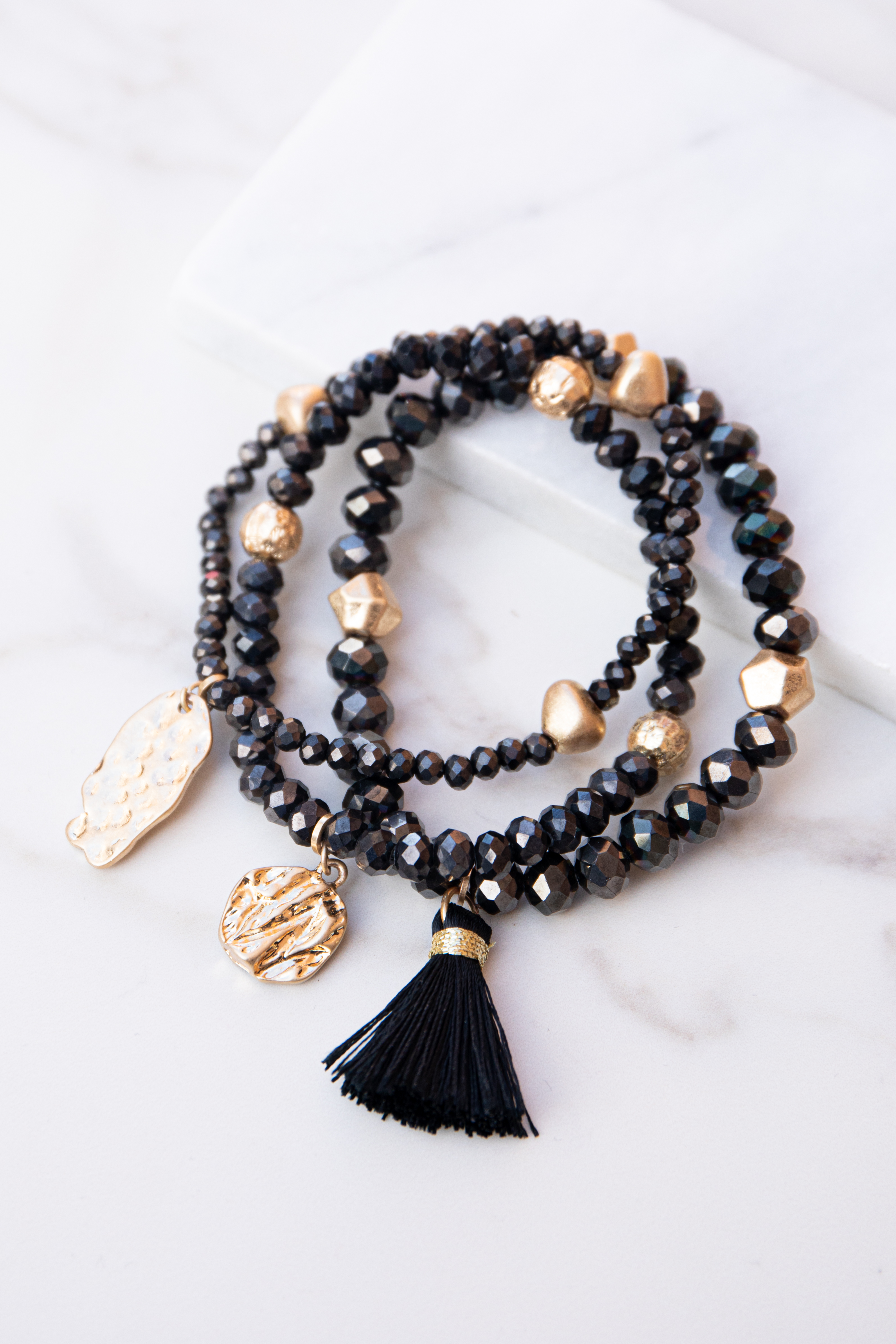 Black and Gold Beaded Bracelet Set with Tassel and Charms