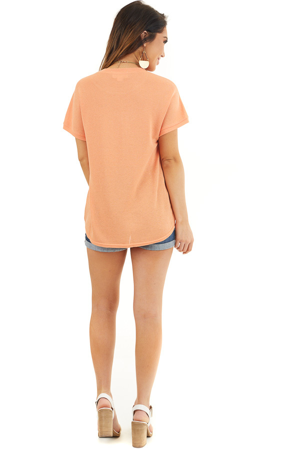Bright Orange Short Sleeve Knit Top with Front Knot back full body