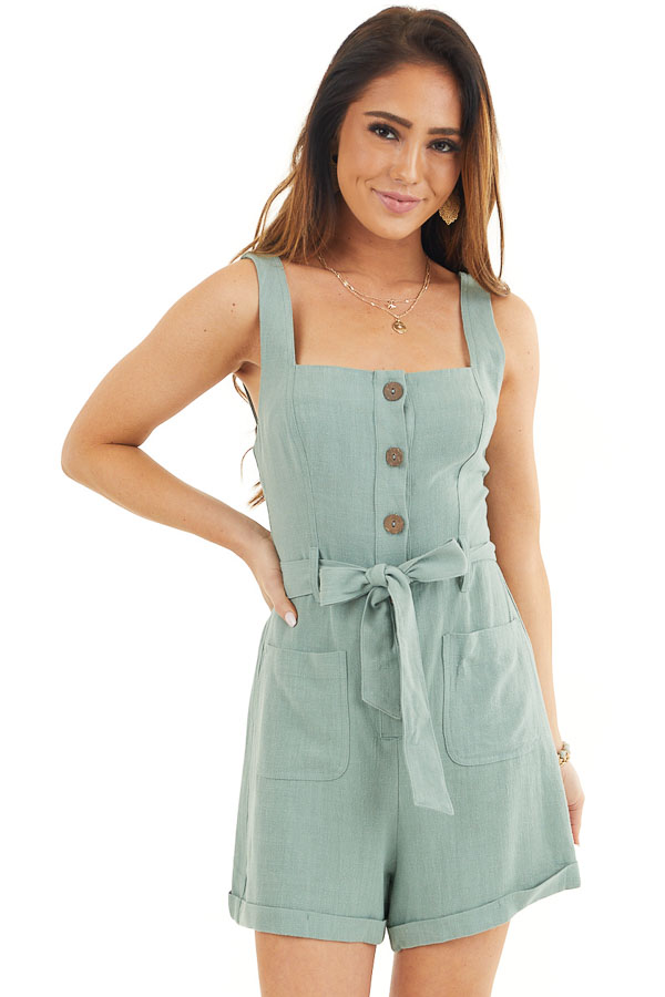 Sage Sleeveless Button Up Romper with Pockets and Tie Detail front close up