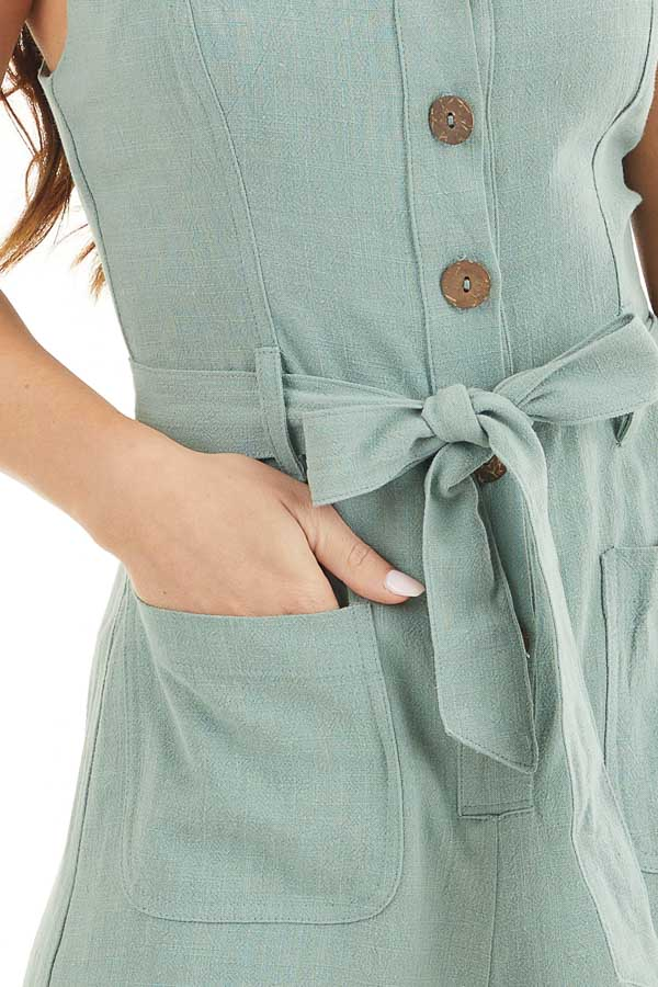 Sage Sleeveless Button Up Romper with Pockets and Tie Detail detail