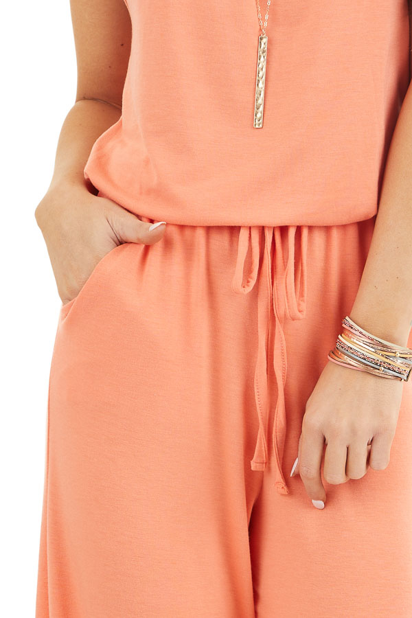 Coral Sleeveless Knit Jumpsuit with Side Pockets detail