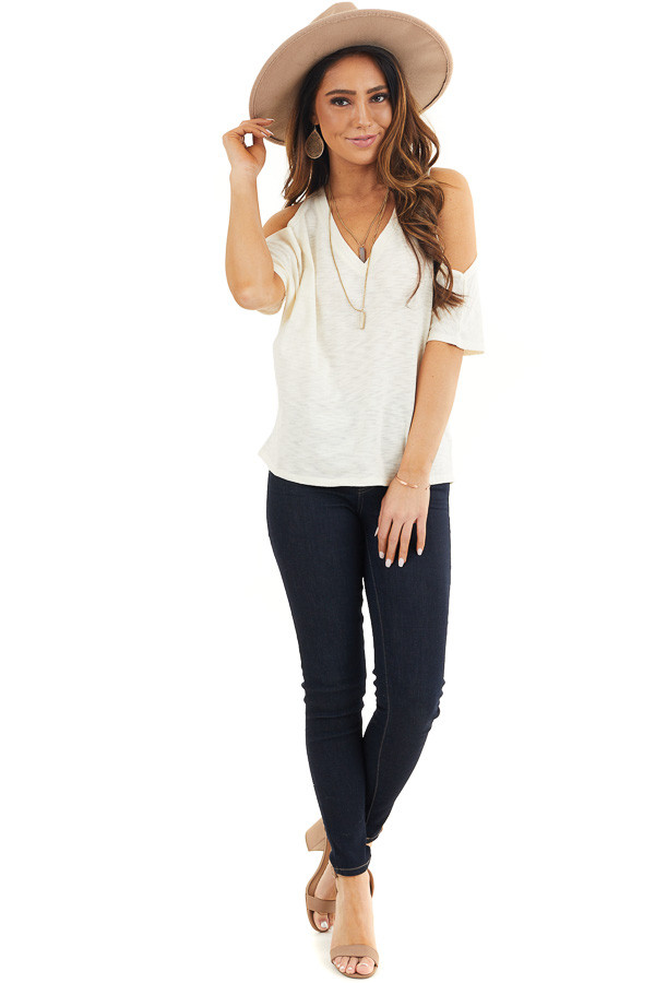 Cream Short Sleeve Top with V Neckline and Cold Shoulders front full body