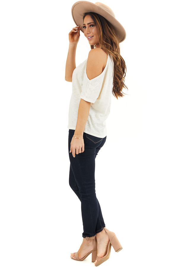 Cream Short Sleeve Top with V Neckline and Cold Shoulders side full body
