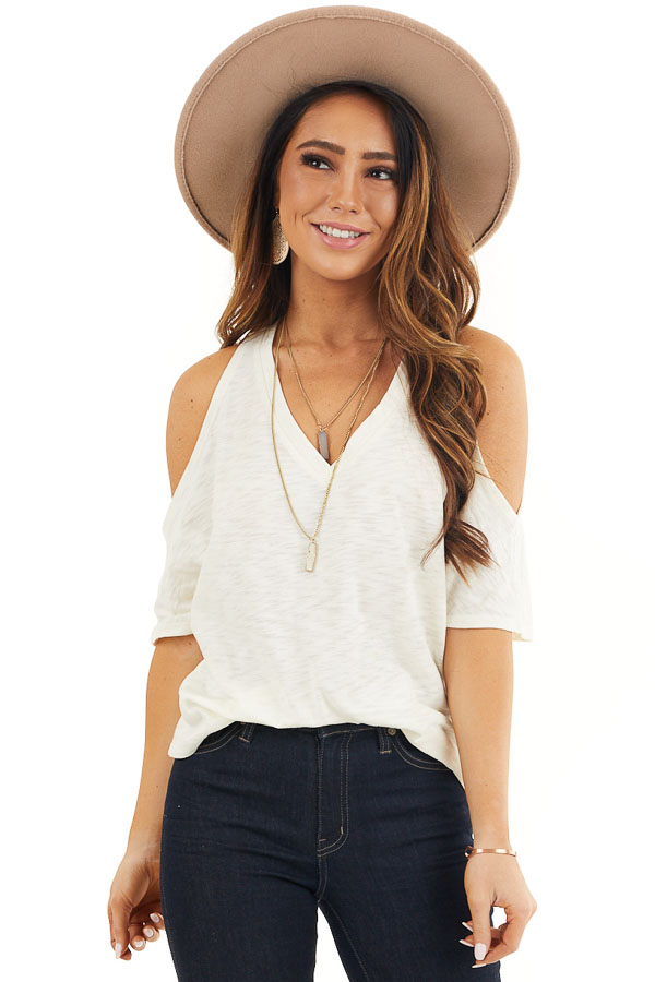 Cream Short Sleeve Top with V Neckline and Cold Shoulders front close up