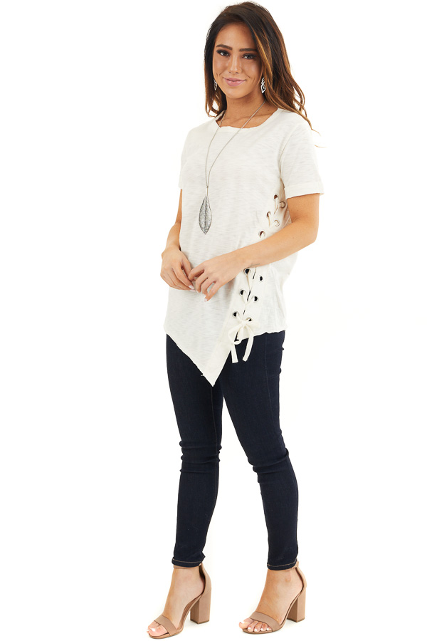 Cream Knit Top with Asymmetrical Hemline and Lace Up Detail front full body