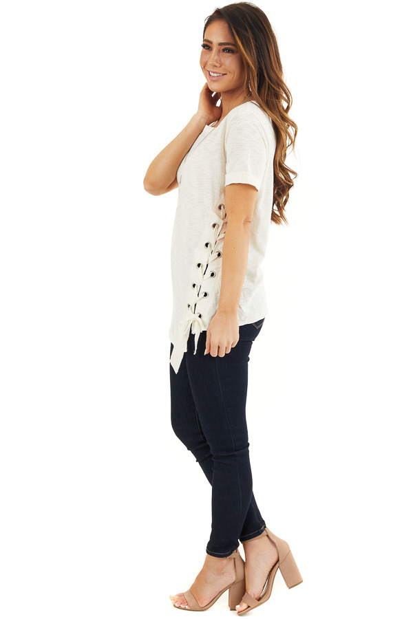 Cream Knit Top with Asymmetrical Hemline and Lace Up Detail side full body