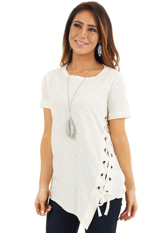 Cream Knit Top with Asymmetrical Hemline and Lace Up Detail front close up