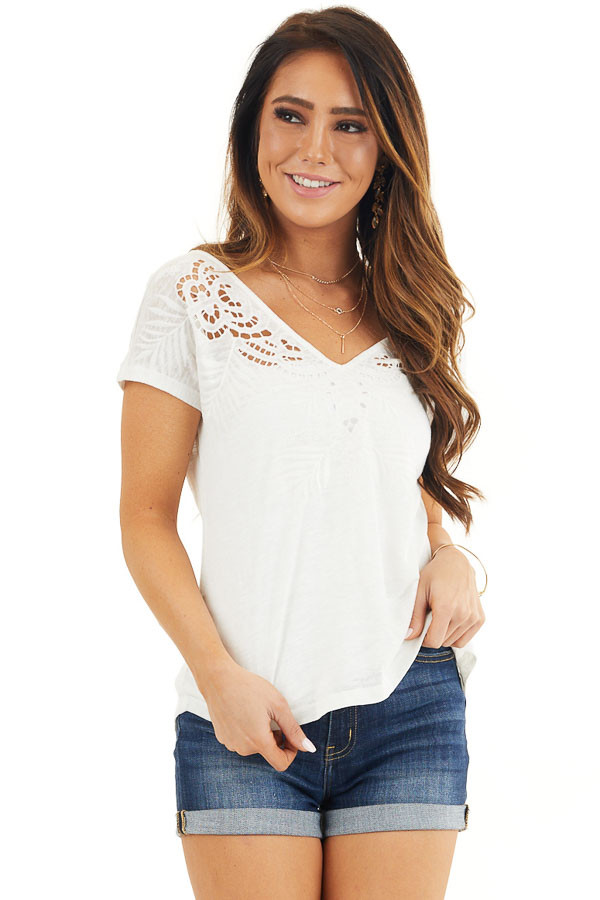 Off White V Neck Top with Criss Cross Back and Embroidery front close up