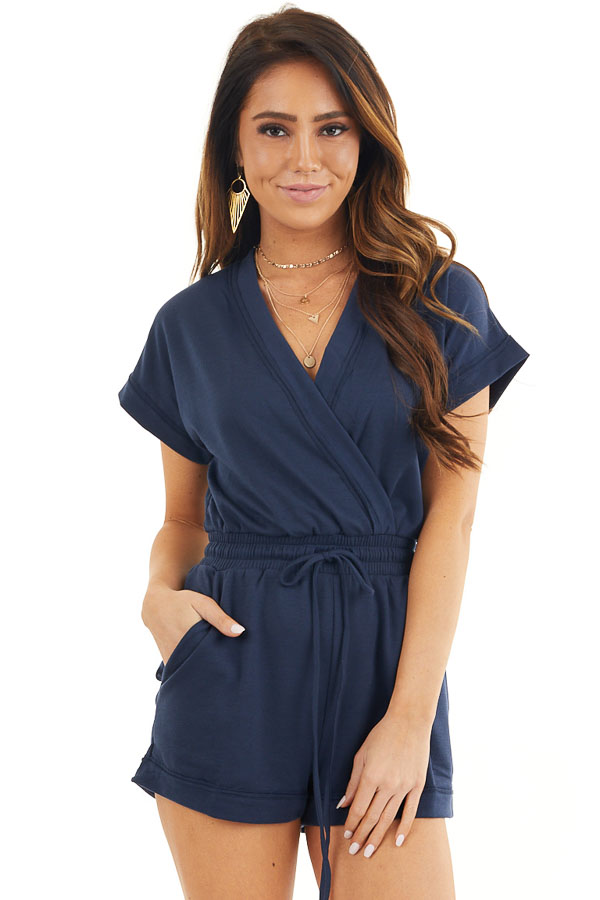 Navy Short Sleeve Surplice Romper with Side Pockets front close up