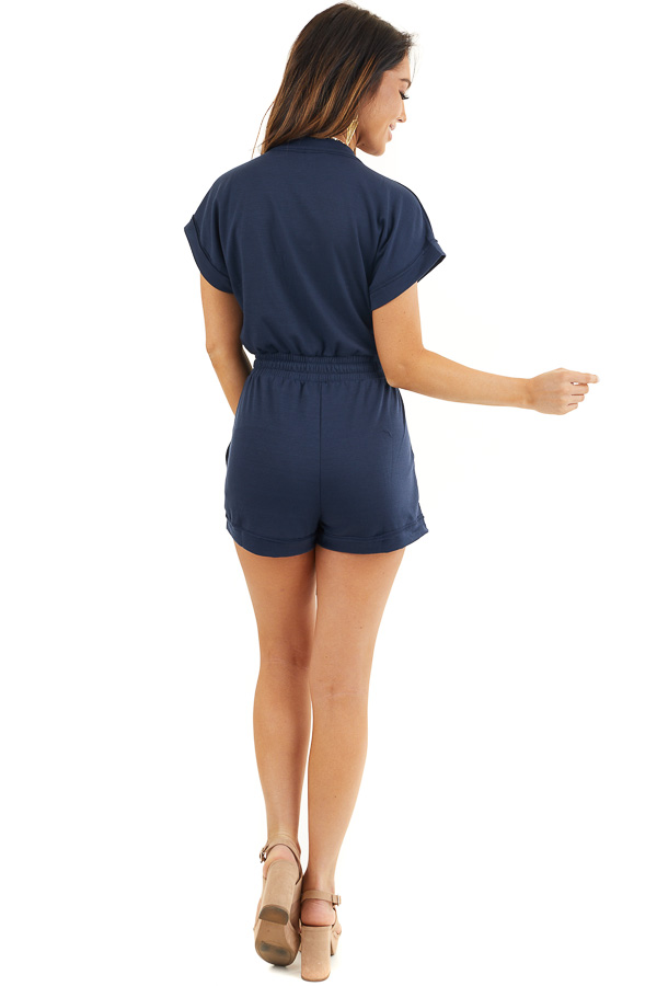 Navy Short Sleeve Surplice Romper with Side Pockets back full body
