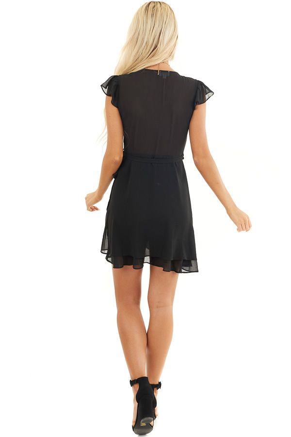 Black Short Sleeve Wrapped Mini Dress with Ruffle Details back full body