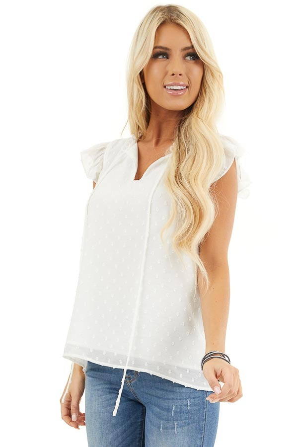 Off White Swiss Dot Top with V Neck Cutout and Tie Closure front close up