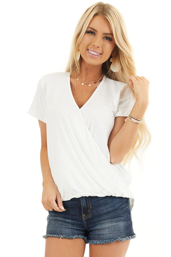 Off White Short Sleeve Surplice Top with Bubble Hemline front close up
