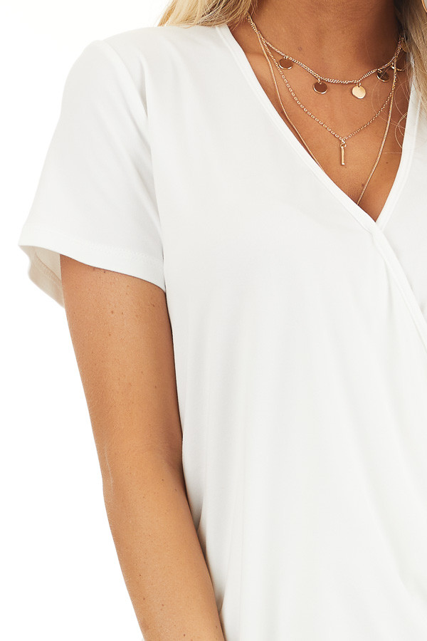 Off White Short Sleeve Surplice Top with Bubble Hemline detail