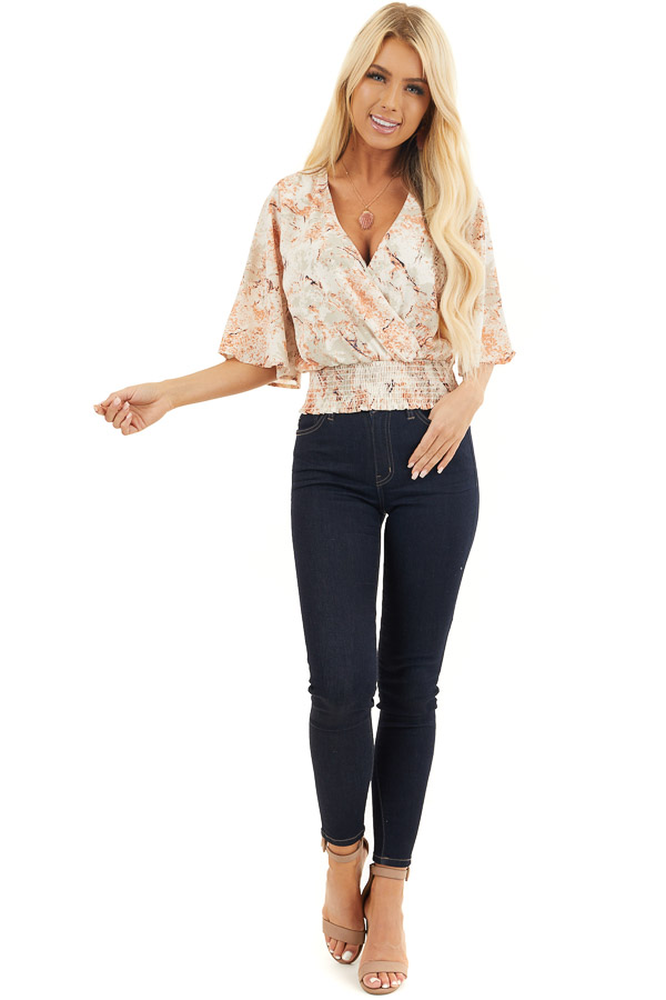 Ivory and Salmon Printed Surplice Top with Smocked Hemline front full body