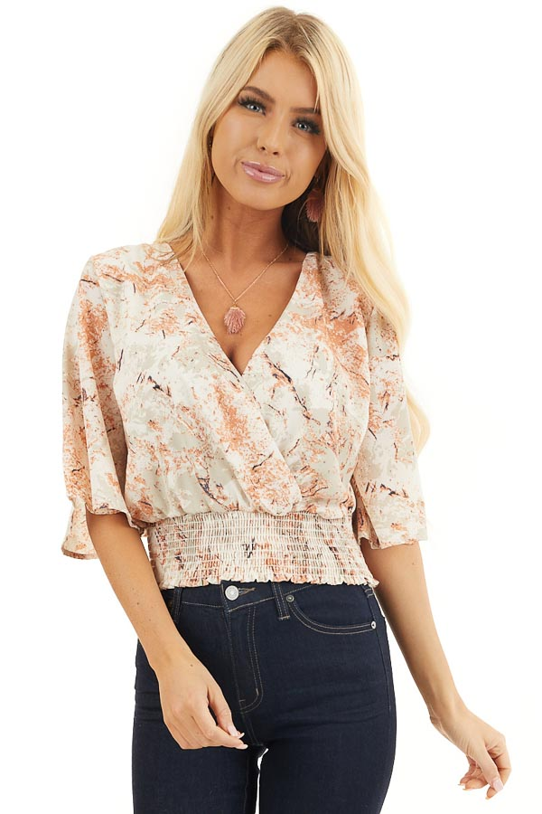 Ivory and Salmon Printed Surplice Top with Smocked Hemline front close up